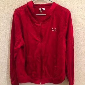 Red hoodie with pig cartoon detailing
